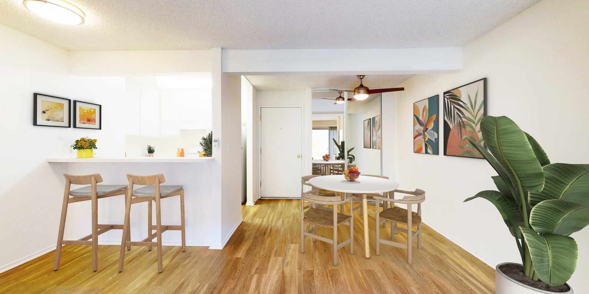 Kitchen and dining area in a one-bedroom apartment at Village Pointe in Northridge, California
