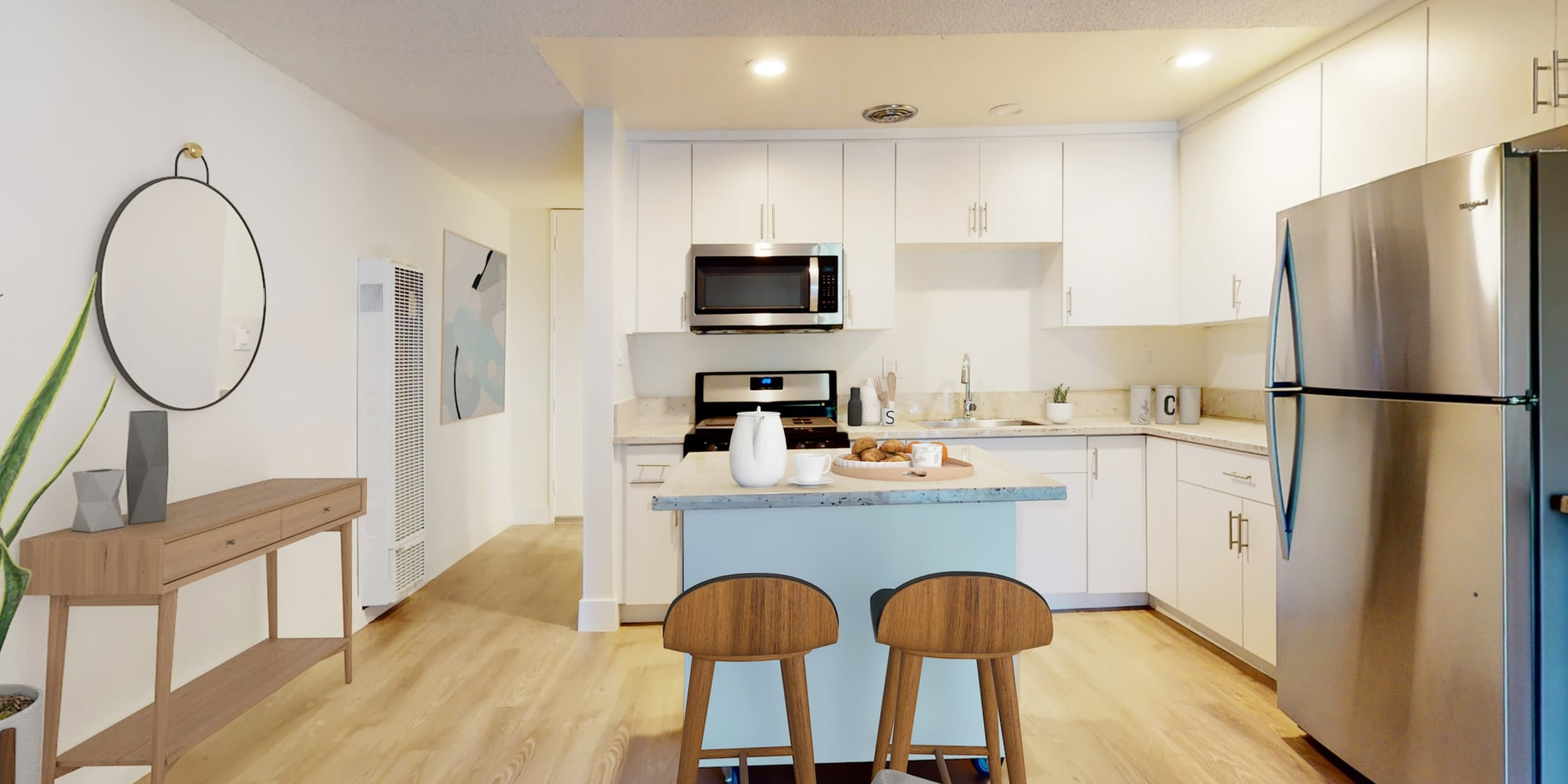 Studio apartment with free-standing island at Mediterranean Village in West Hollywood, California