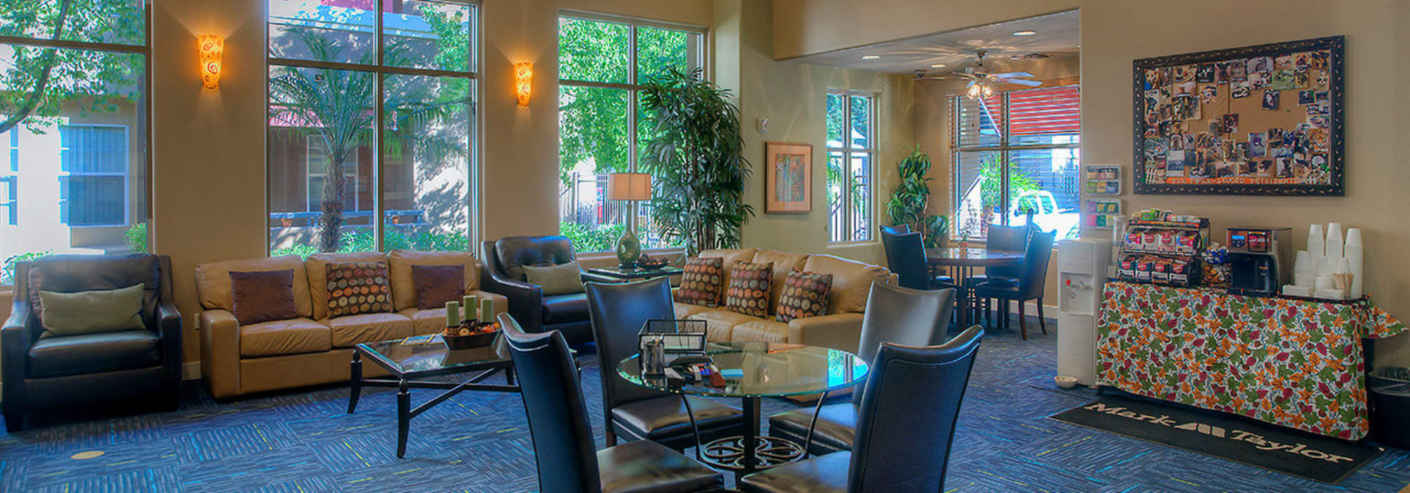 Resident clubhouse with tables and couches to entertain friends at Park on Bell in Phoenix, Arizona