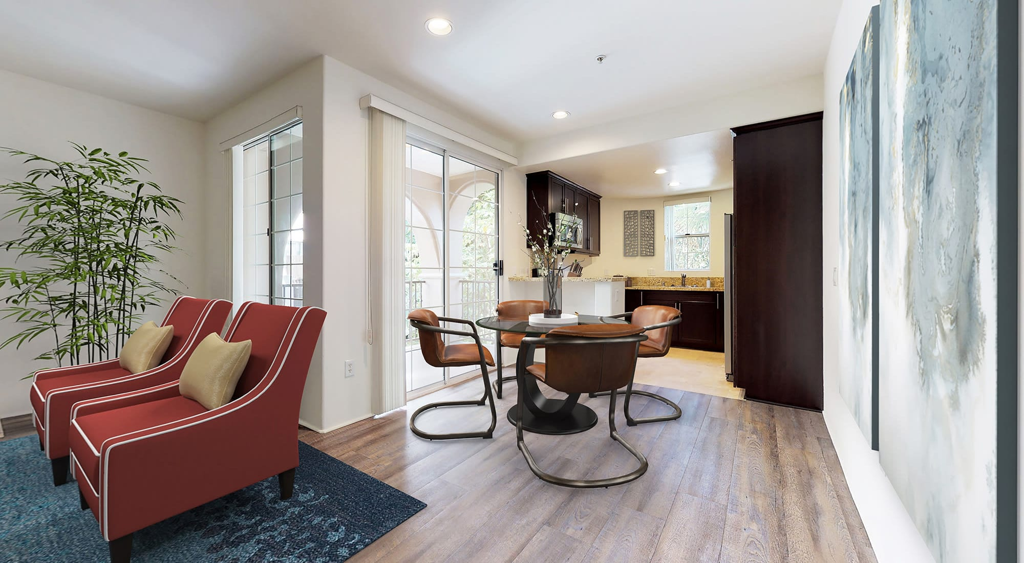 Open-concept living areas with hardwood flooring throughout in a model home at L'Estancia in Studio City, California