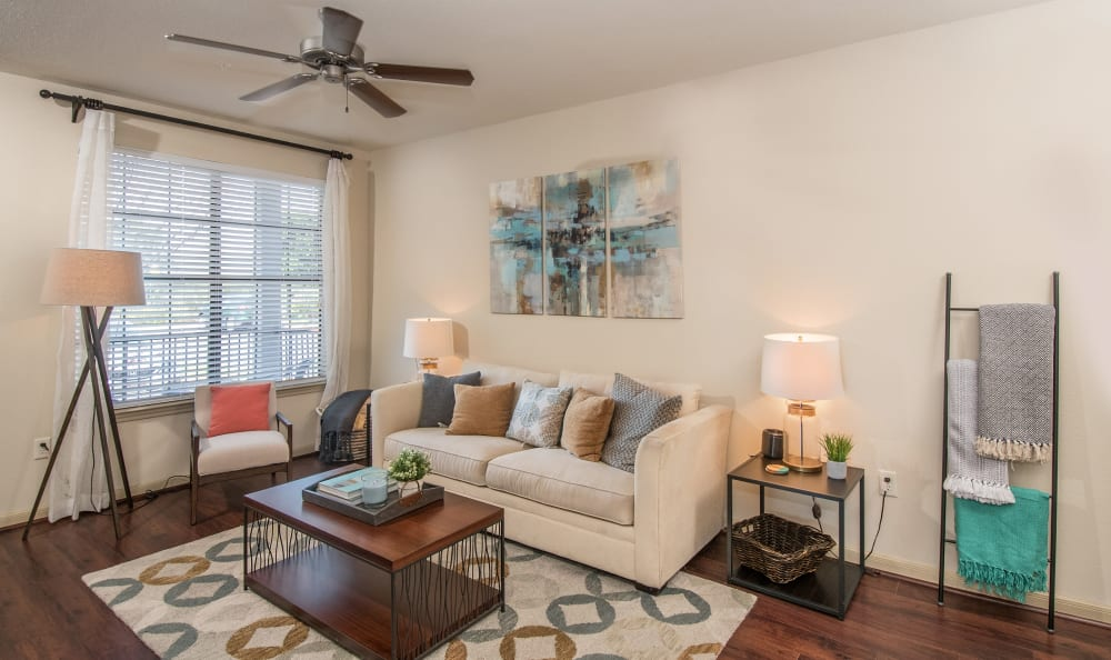 Living room with a ceiling fan at Villas Tech Ridge in Pflugerville, Texas