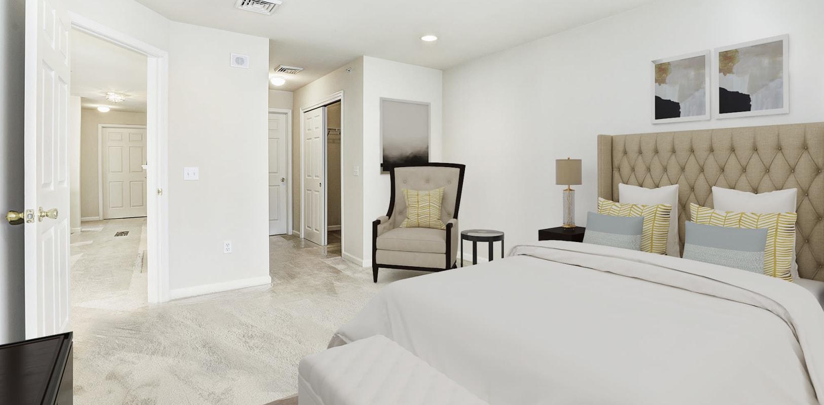 Large master bedroom with woo-style flooring at Hanover Glen in Bethlehem, Pennsylvania