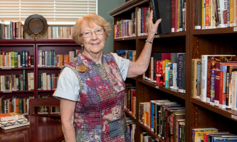 A resident in a library at The Keystones of Cedar Rapids in Cedar Rapids, Iowa