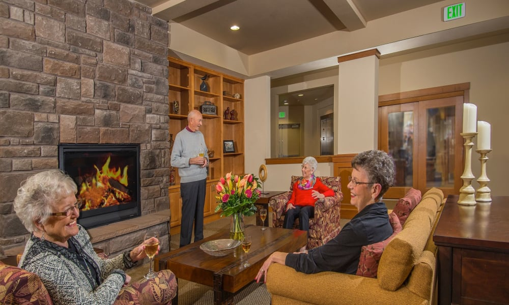 Seniors gathered in one of the lounges at Quail Park at Browns Point in Tacoma, Washington