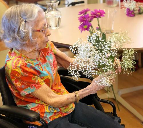 Happy senior woman at Eastern Star Masonic Retirement Campus in Denver, CO