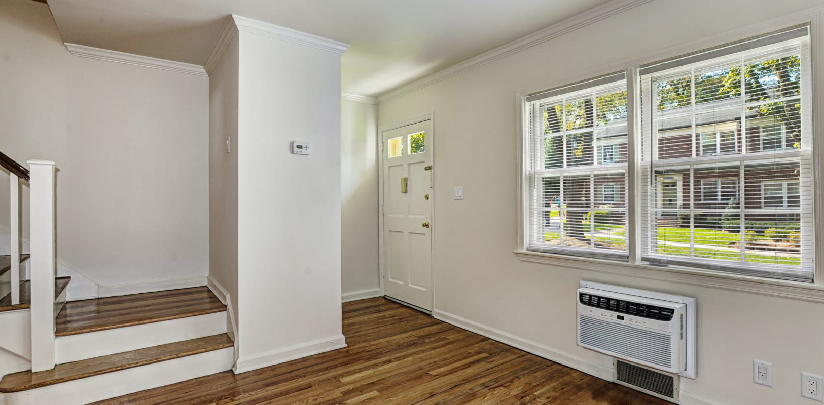 Wood-style flooring with white walls in a living area at General Wayne Townhomes and Ridgedale Gardens in Madison, New Jersey