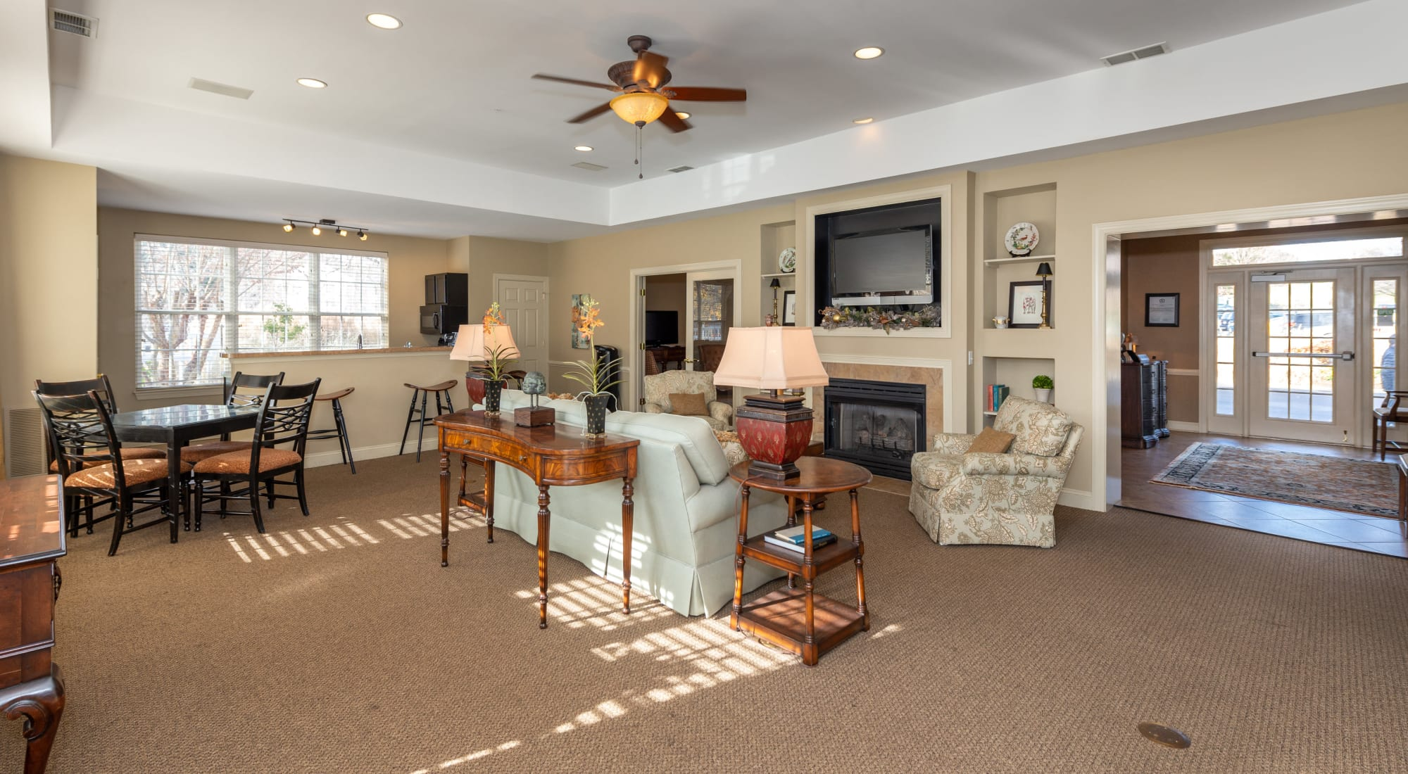 Spacious resident lounge with a flat-screen TV and fireplace at The Overlook at Stonemill in Lynchburg, Virginia