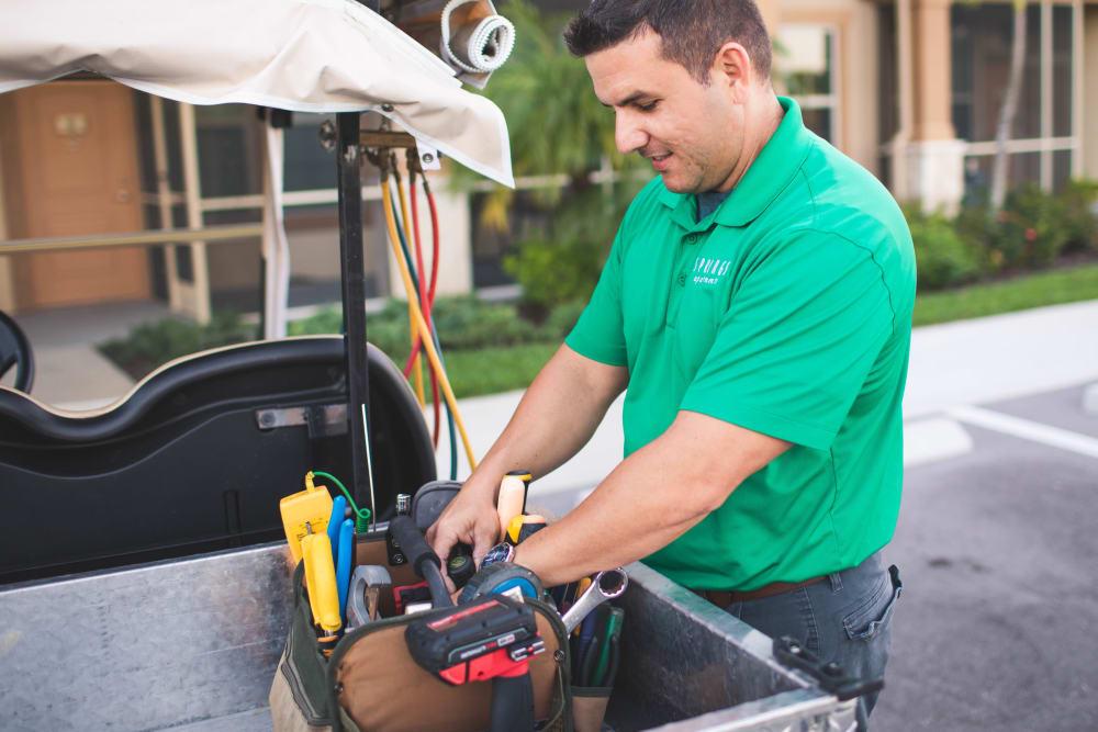 24-Hour Emergency Maintenance Team Member and Golf Cart at Springs at Egan Drive in Savage, MN