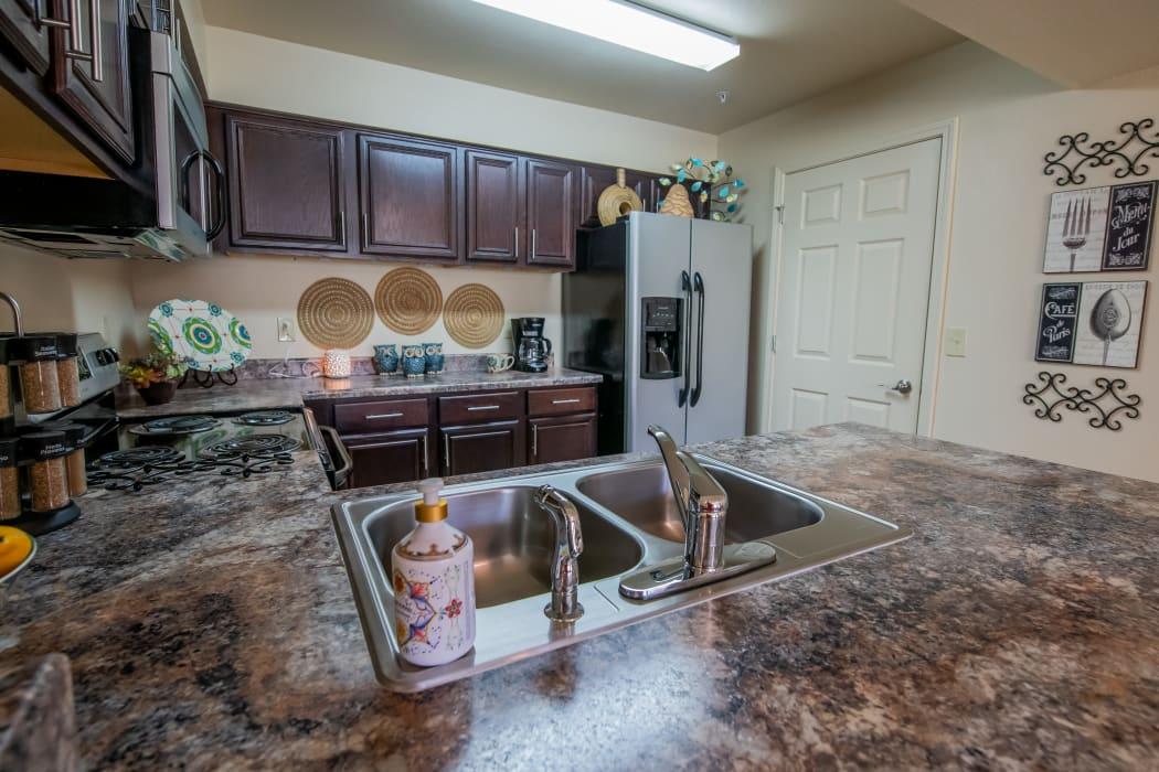 Well equipped kitchen with pantry at Park at Tuscany in Oklahoma City, Oklahoma