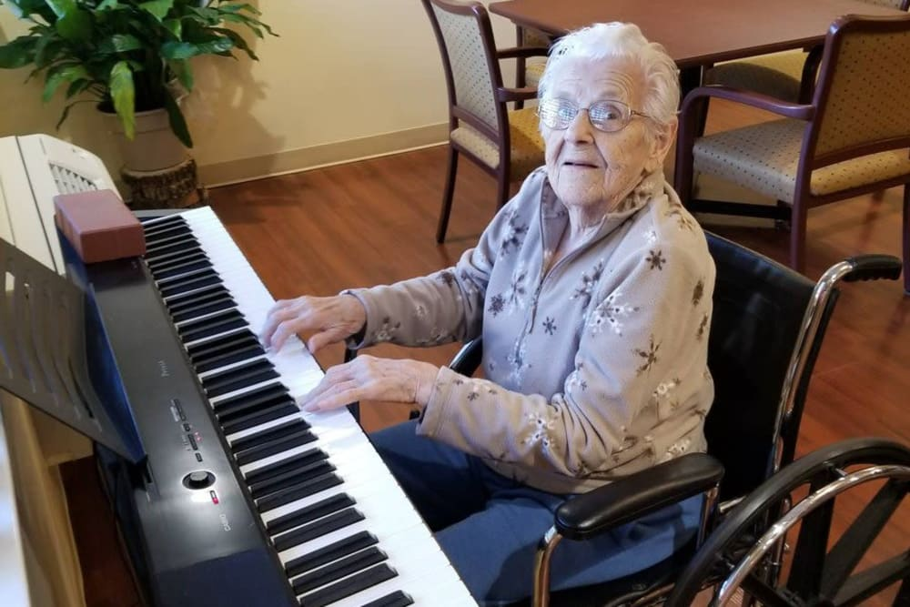 A resident playing the keyboard at Woodmont Health Campus in Boonville, Indiana