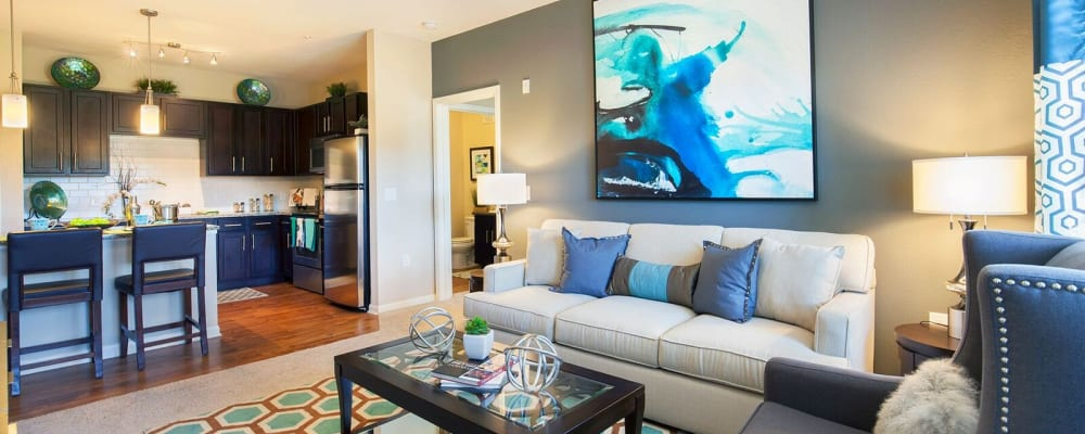 Well decorated living room in model home at Integra Hills Preserve Apartments in Ooltewah, Tennessee