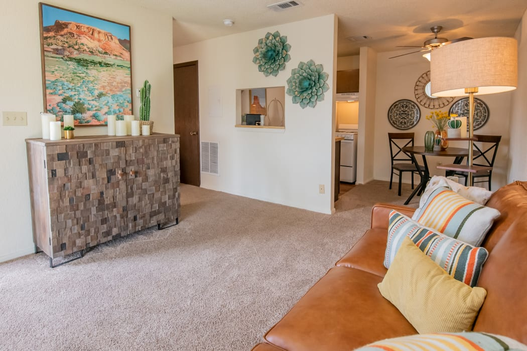 Beautifully decorated living room at Aspen Park Apartments in Wichita, Kansas