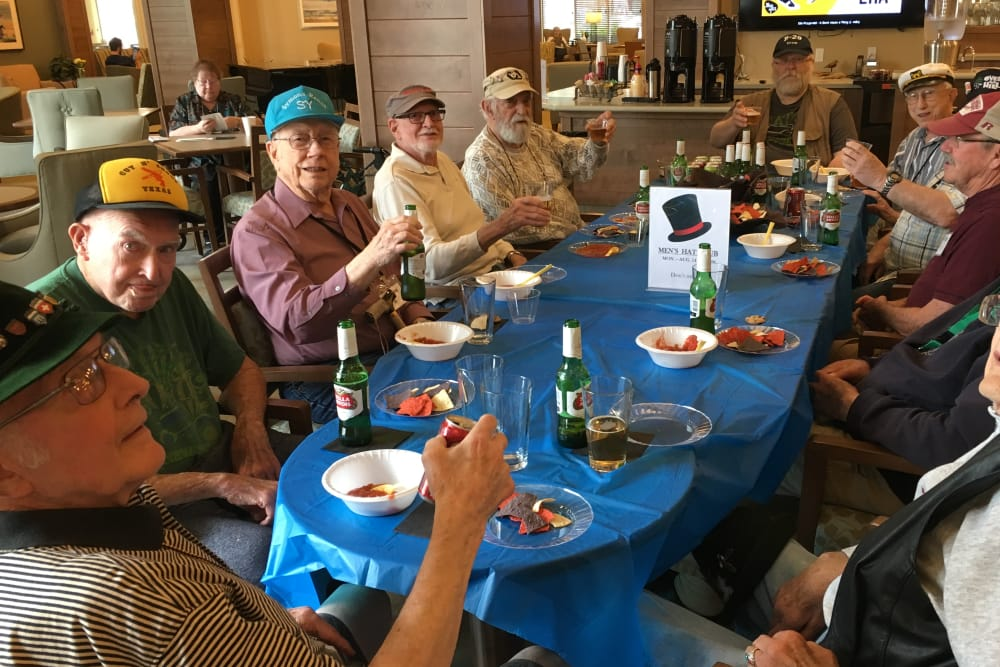 Friends and residents enjoying Anytime Dining at Merrill Gardens at Burien in Burien, Washington.