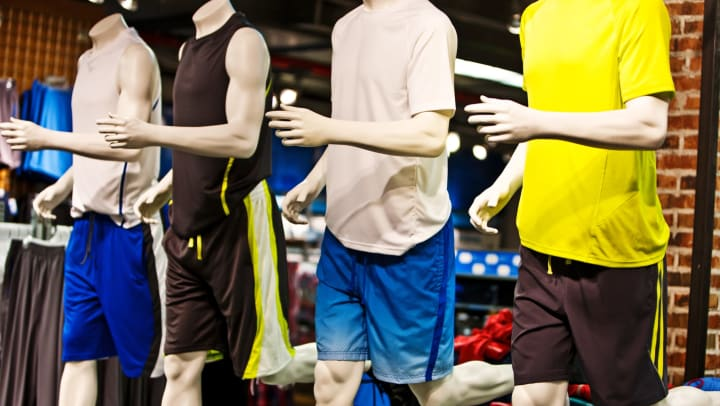 Mannequins at store showcasing athletic clothes.