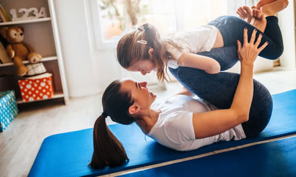 Mother and daughter doing yoga at Iris Apartments in Memphis, Tennessee