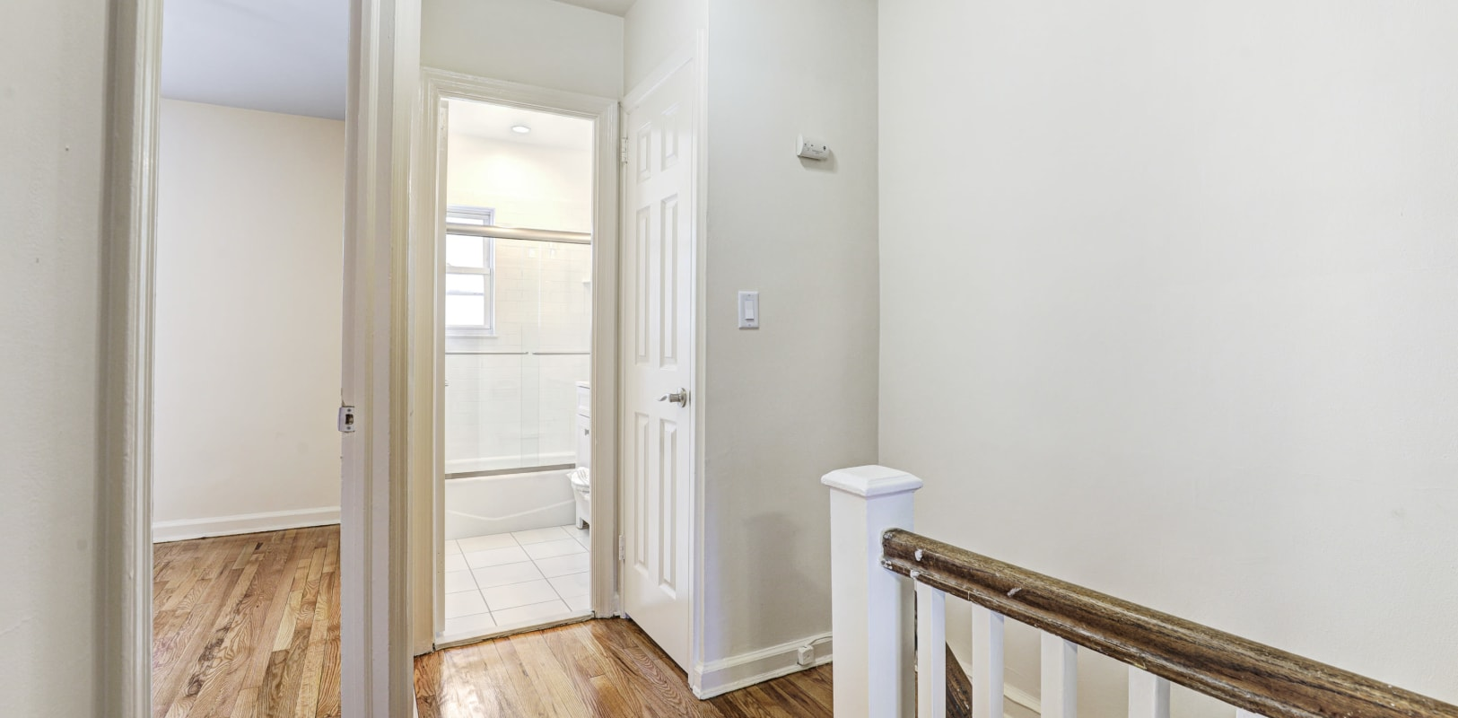 Clean, streamlined upstairs hallway at General Wayne Townhomes and Ridgedale Gardens in Madison, New Jersey