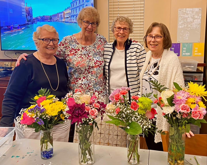 Tacoma residents gather around to show off their brand new floral arrangements.