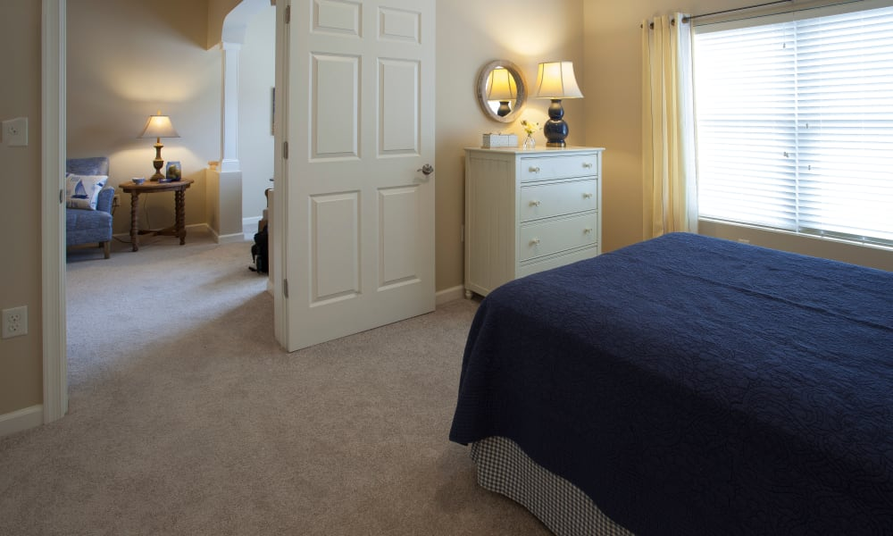 A bedroom leading to the living room at Keystone Place at  Buzzards Bay in Buzzards Bay, Massachusetts