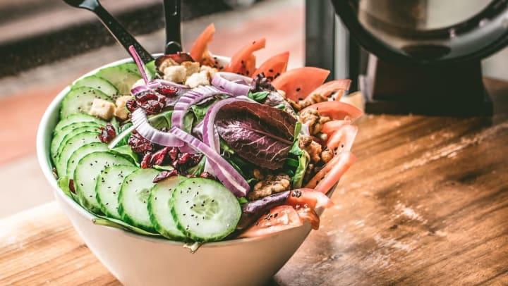 Tasty fresh salad from restaurant near Mirador & Stovall at River City Apartments in Jacksonville, Florida