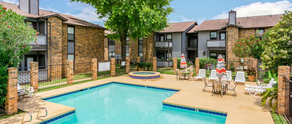 Gorgeous swimming pool area at North Pointe Apartments on a sunny day in Bossier City