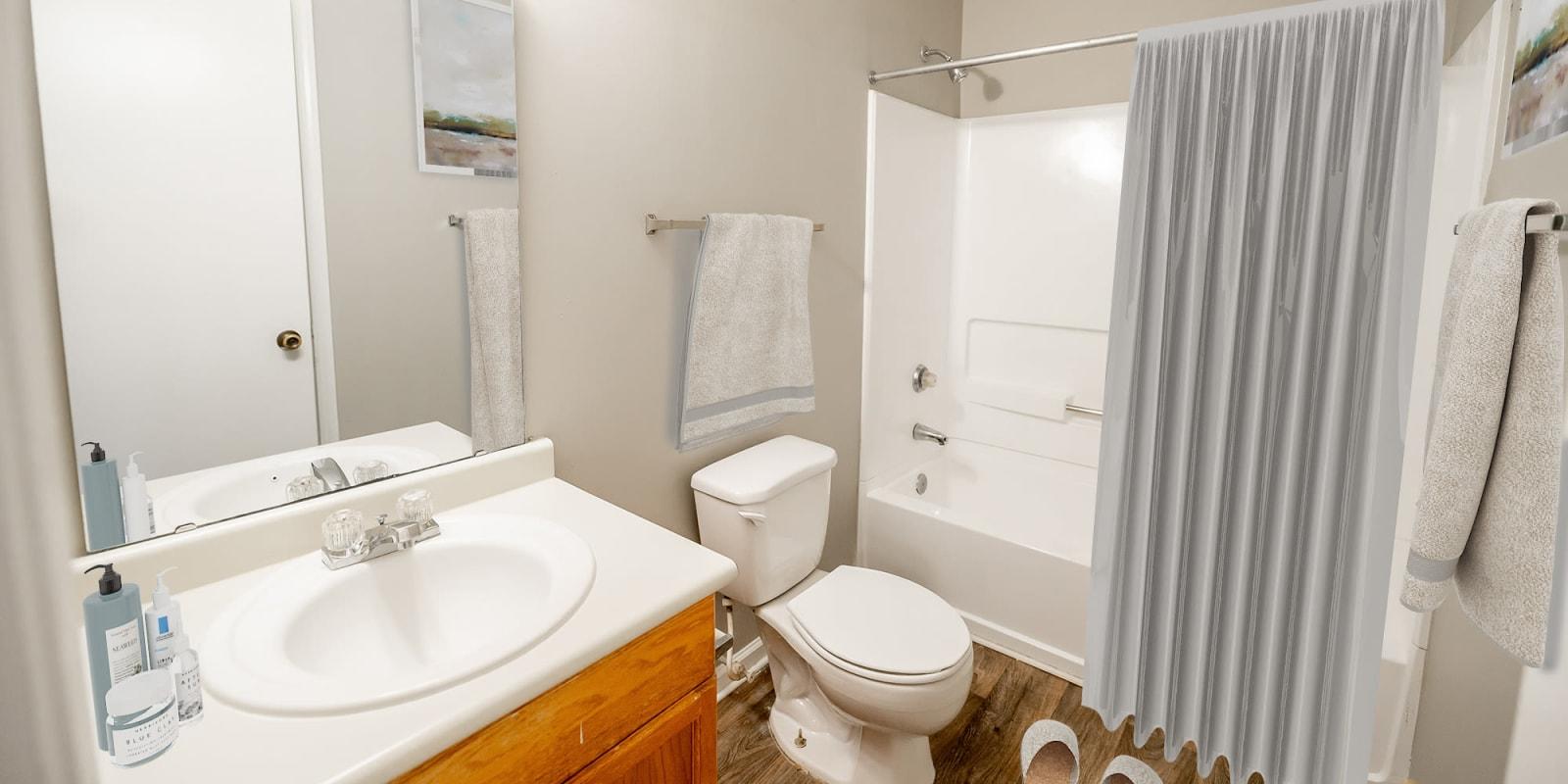 Bright Bathroom at Kannan Station Apartment Homes in Kannapolis, North Carolina