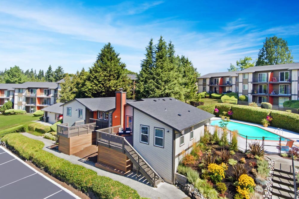 Leasing office with the swimming pool area and resident buildings in the background at Haven Apartment Homes in Kent, Washington