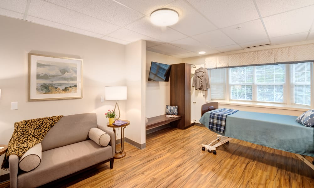 A resident suite with a couch at Mission Healthcare at Bellevue in Bellevue, Washington.