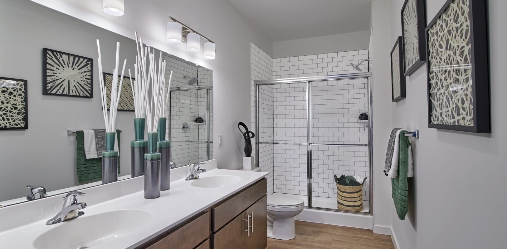 Double sinks and a walk-in shower in a model home bathroom at The Mills at Lehigh in Bethlehem, Pennsylvania