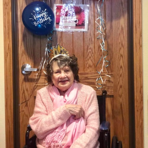 Resident celebrating her birthday at Oxford Glen Memory Care at Sachse in Sachse, Texas