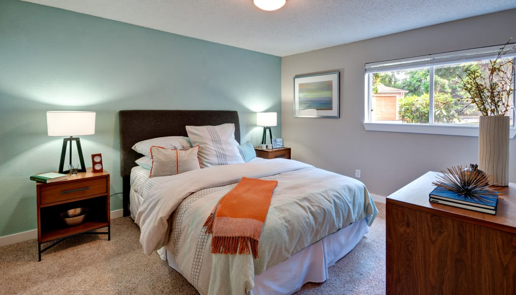 Spacious and bright master bedroom in model home at StonePointe in University Place, WA
