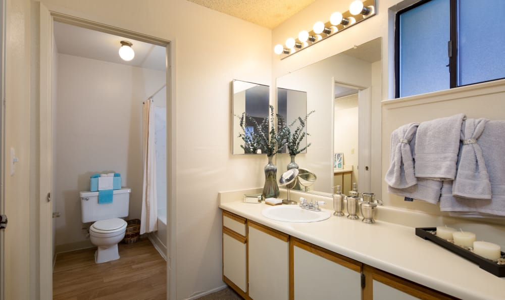 A spacious and well-lit bathroom at Bennington Apartments