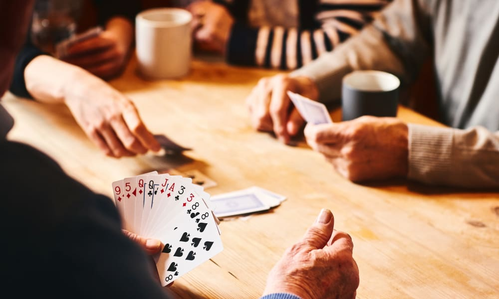 Residents playing cards at The Arbours at Linden Pointe in Winnipeg, Manitoba