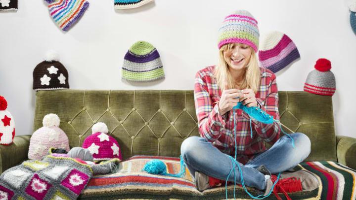 Women at home knitting at Olympus on Main in Carrollton, Texas