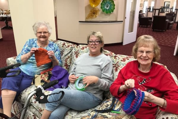 Three residents knitting at Magnolia Heights Gracious Retirement Living in Franklin, Massachusetts