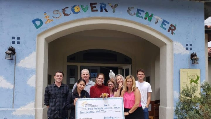 Carlsbad Self Storage presenting check to the Agua Hedionda Lagoon Foundation