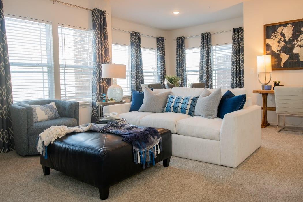 Bright, inviting living room at Artisan Crossing in Norman, Oklahoma