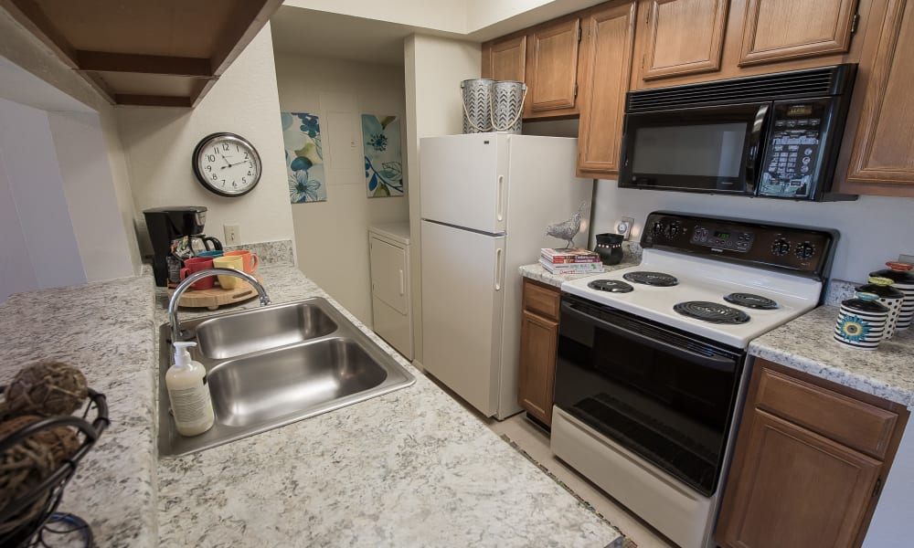 An apartment kitchen at The Courtyards in Tulsa, OK