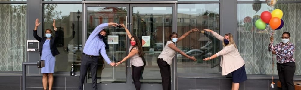 Employees wearing a mask outside of Edgewood Management in Gaithersburg, Maryland