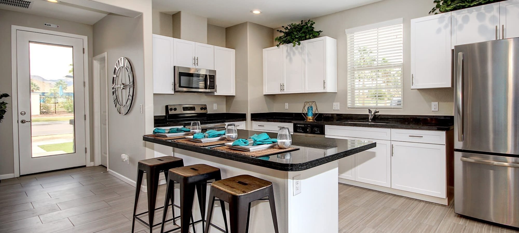 Modern kitchen with stainless-steel appliances at BB Living at Eastmark in Mesa, Arizona