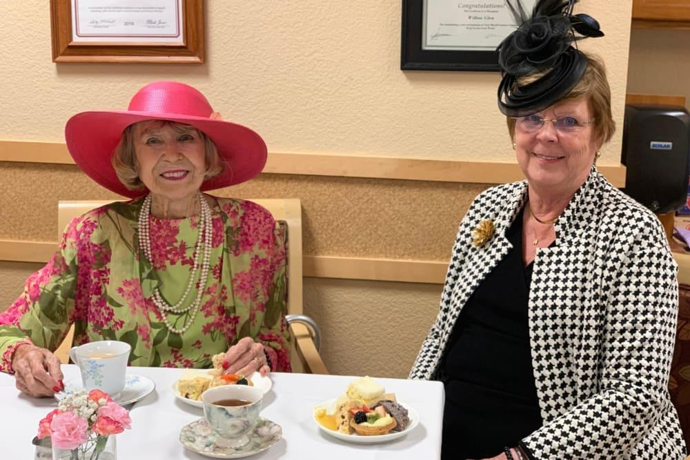 two senior women enjoying desert