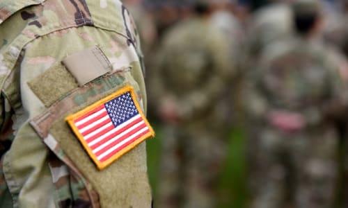 Group of veterans remembering a fallen comrade near Rosewalk in San Jose, California
