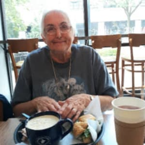 Resident Juanita enjoying breakfast at a local restaurant near Corridor Crossing Place in Cedar Rapids, Iowa.