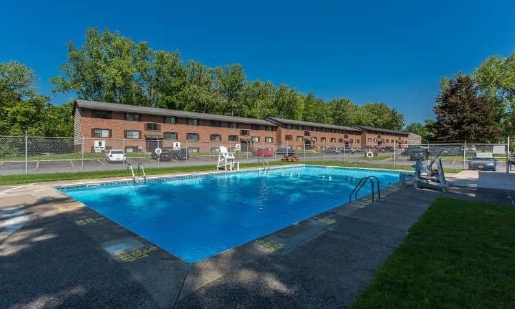 Refreshing swimming pool at The Residences at Covered Bridge in Liverpool, New York