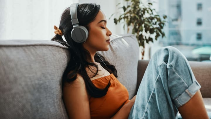 Person listening to music on headphones.