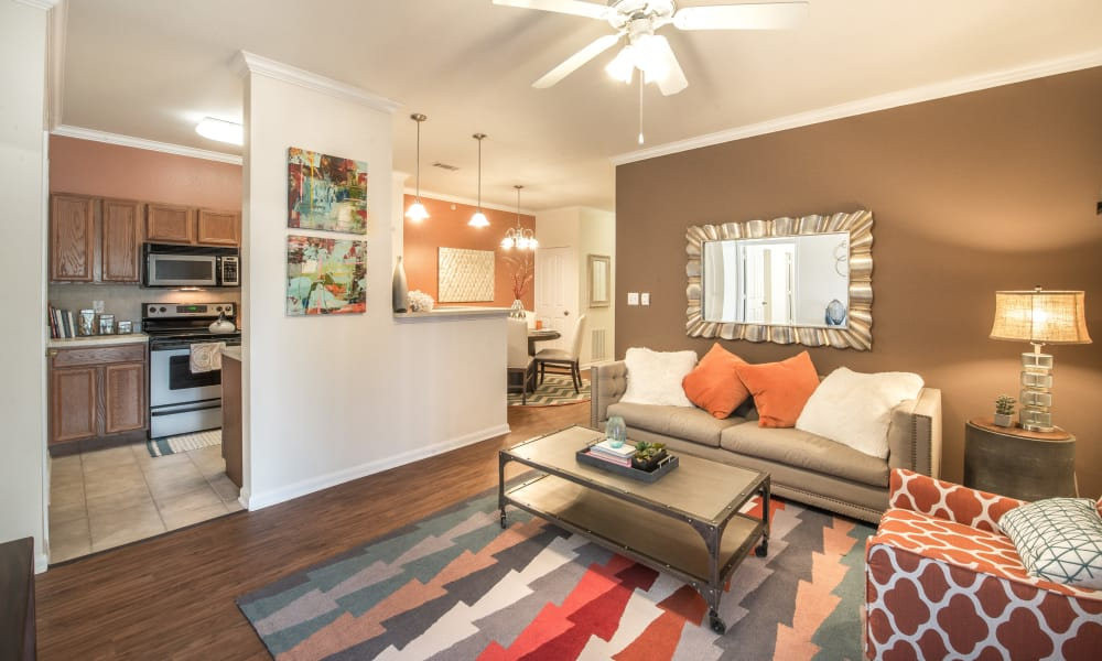 Open-floor plan that leads from the kitchen to the living room at The Atlantic Station in Fort Worth, Texas