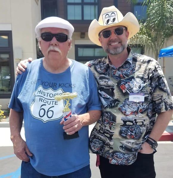 General Manager, David Tamo and resident with a car show trophy
