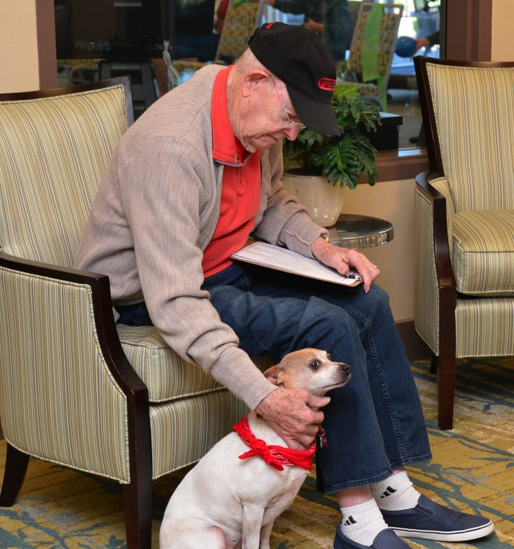 Elderly man with his dog at Waterford Grand in Eugene, OR
