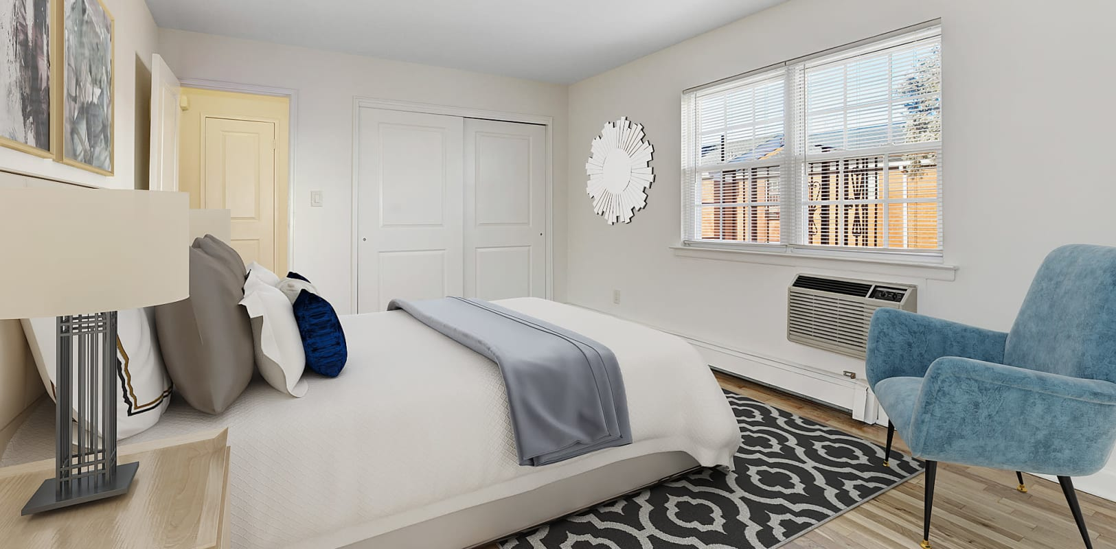 Bedroom with large closet and air conditioning unit at Park Lane Apartments in Little Falls, New Jersey
