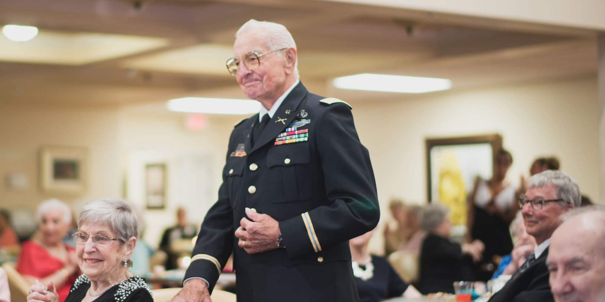 A veteran resident being honored at Liberty Heights Gracious Retirement Living in Rockwall, Texas