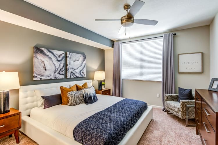 Modern bedroom with carpet and a ceiling fan in model home at The Pearl in Ft Lauderdale, Florida